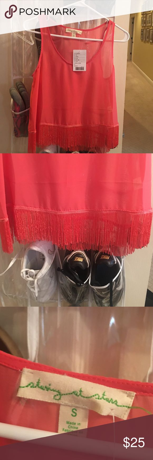 Pink fringe top Never worn. Cute pink fringe top. Tags still on. Size small Tops Tank Tops