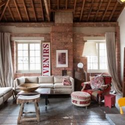 Exposed brick walls and high ceilings, this London loft has it all.