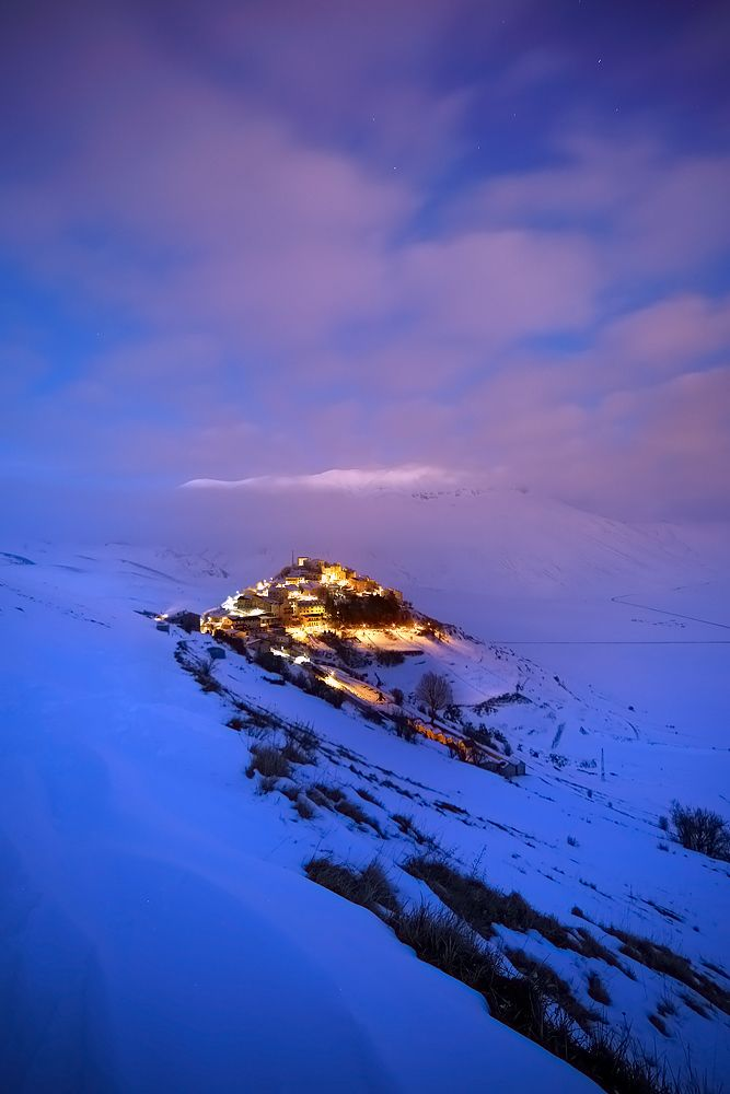 Winter landscape: Castelluccio of Norcia in Umbria, Italy - Tourism Marketing Concepts