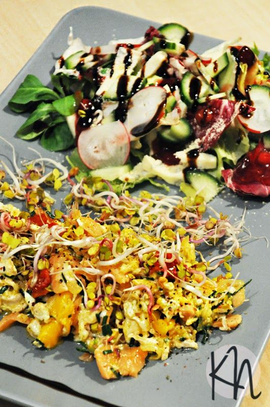 quick and tasty breakfast: scrambled eggs with salmon, spring onion and sprouts