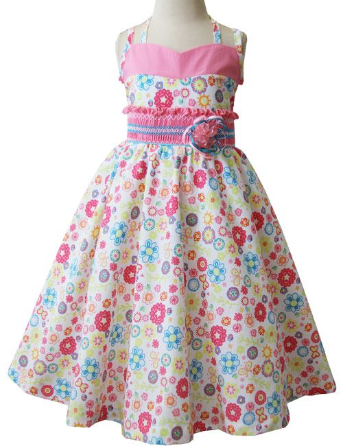 Girls beautiful twirly spring pink summer dress. Beautiful fabric with printed flowers, butterflies and paisleys. Fully lined.