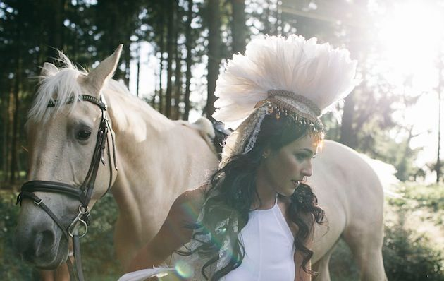 bride in a feathered headdress & her horse // Kytography