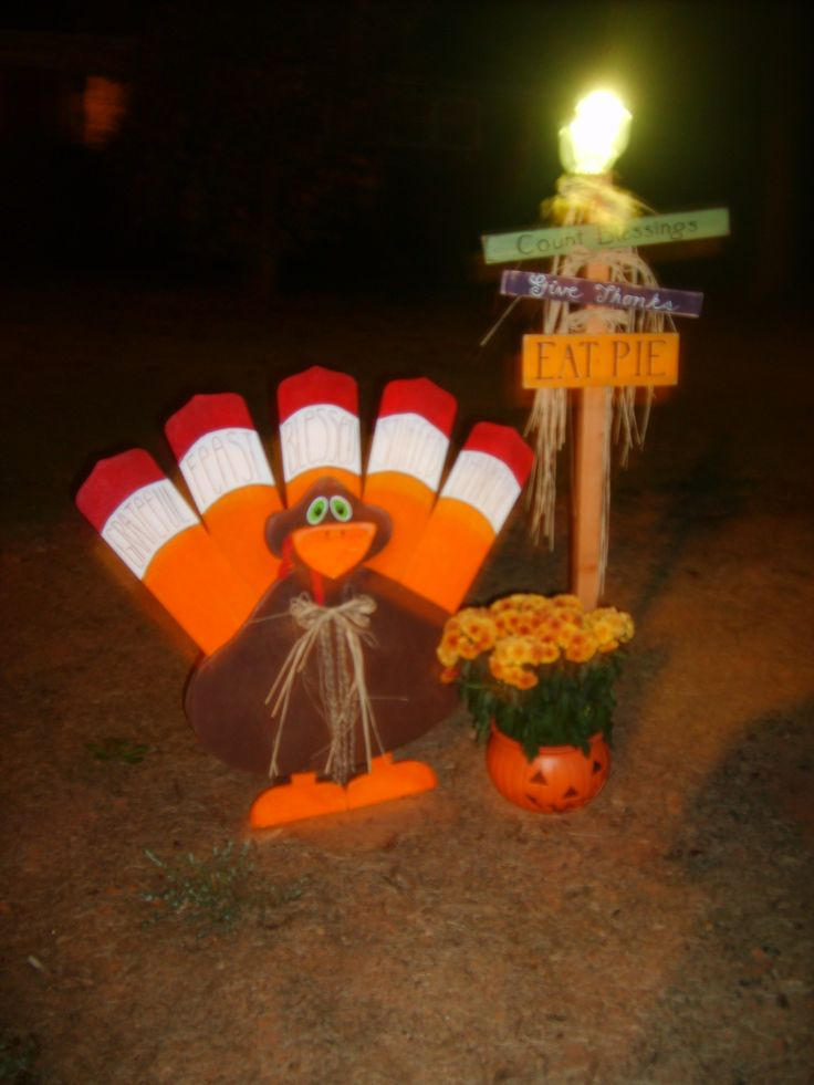 Turkey made with reclaimed wood. Tail is old ceiling fan blades. Body and head from plywood scraps.   Sign is from wood scrap with a solar path light on top.  Both were inspired by other Pinterest pins.  http://www.etsy.com/listing/110379526/xxl-thanksgiving-turkey-painted-wood  http://www.pinterest.com/pin/52143308158982573/