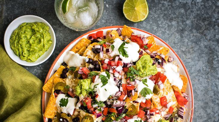 Get your summer parties started with a platter of fully loaded nachos your guests are bound to love!