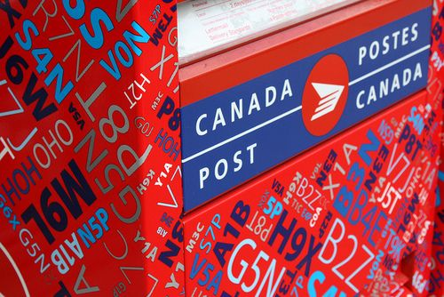 Canada, the postal service.  Canadians are loosing their home delivery of mail.  Take a picture of your Postman to show your children and grandchildren this soon to be obsolete job.