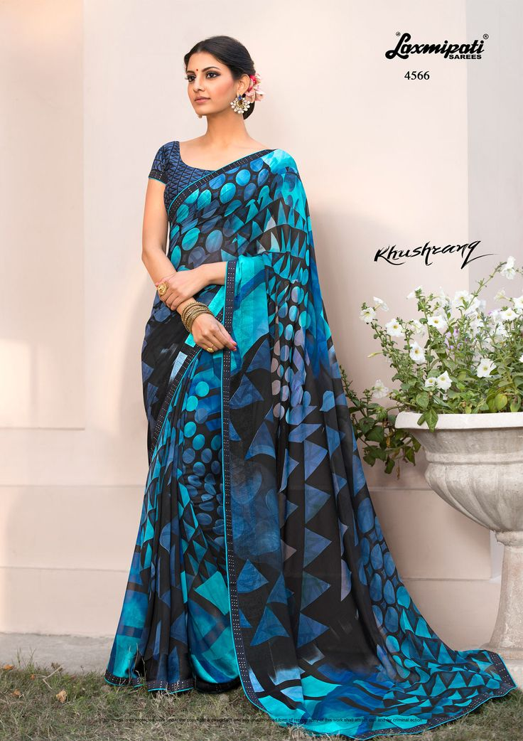 Explore the Laxmipati Black & Blue Designer Printed #Georgette_Sarees and Navy Blue Brocade Blouse along with Rawsilk Stone Work Lace Border for your special occasion. #Catalogue-#KHUSHRANG #Price - ₹ 1992.00 #Designnumber-4566
