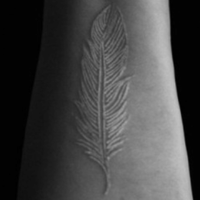White ink  feather tattoo, want ! <3