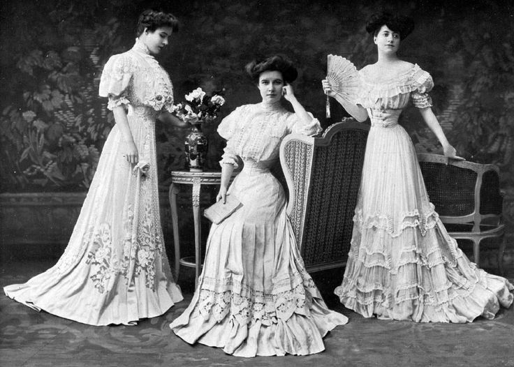 1907: I think what we have here are variations of a lacy summer style, with an afternoon gown at left, day dress center, and evening gown right. JC