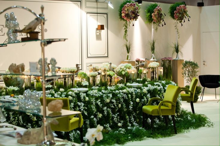 Greenery and white flowers table cloth Fair installations