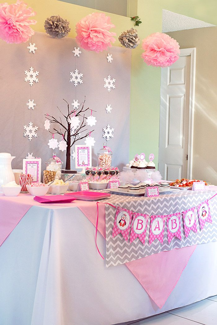 This Winter Wonderland Baby Shower is so precious for a new baby girl on the way! Styled with pink, silver, snowflakes and the most adorable little penguin.
