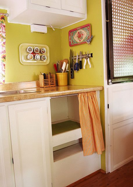 Magnetic spice tray & knife rack - great use of space in an RV kitchen!  Many other nice RV decorating & use ideas.