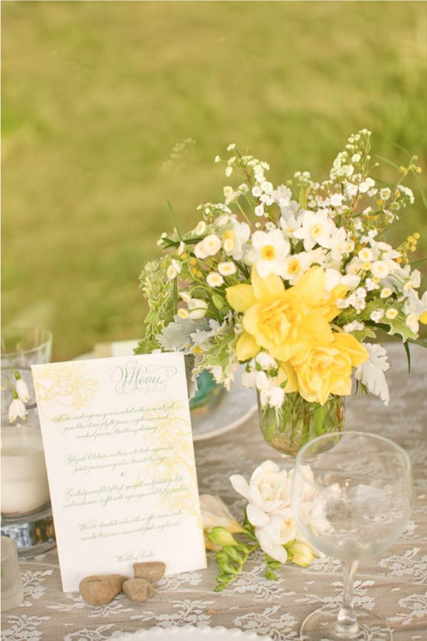 Yellow wild flower centerpiece and lace table linens
