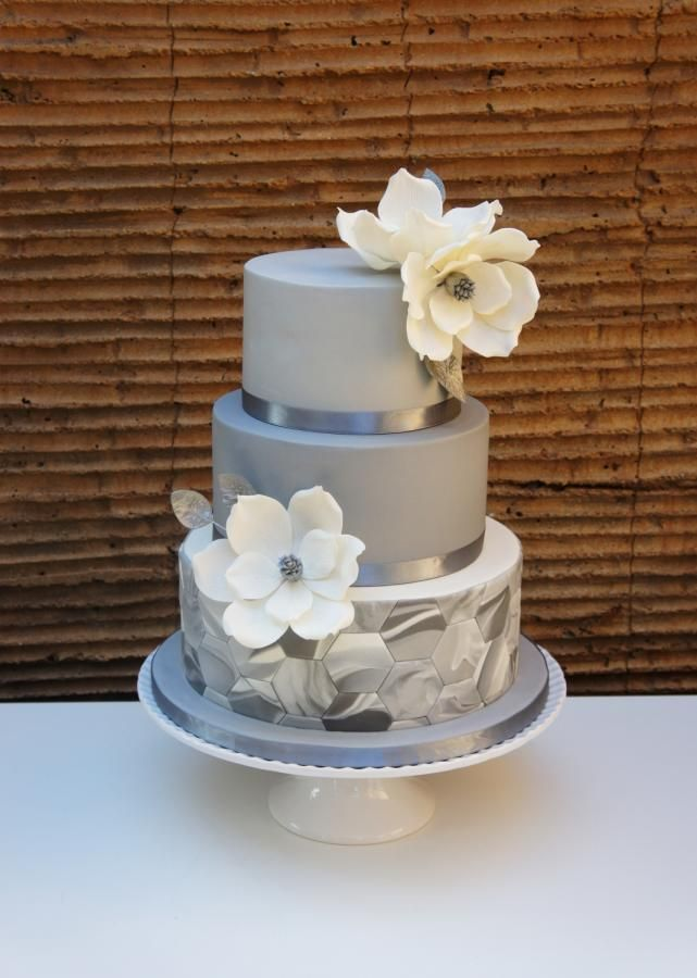 Wedding cake with marble fondant and magnolias by Florence Devouge - http://cakesdecor.com/cakes/269774-wedding-cake-with-marble-fondant-and-magnolias