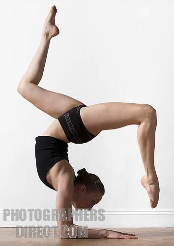 woman in gymnastic pose stock photo