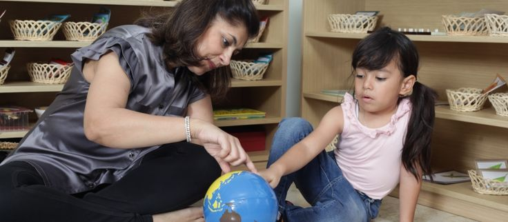 Master Trainer Jenny presenting the Continent Globe to a 4 year old.