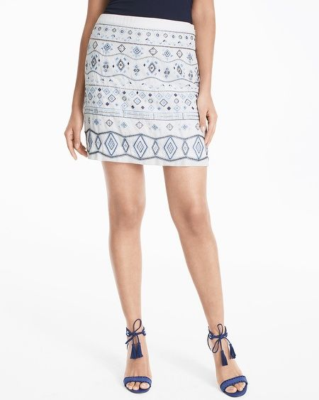 """We always pay attention to delicate details, like the beaded embellishments on our mini skirt. Complete the set with our matching Embellished Cami.  Embellished skirt in white with indigo Sits 1"""" below the waist Hidden side zip with hook-and-eye closure Lined Silvertone hardware Approx. 17 1/2"""" center back length Approx. 4"""" above the knee Polyester. Turn inside out, machine wash cold on gentle cycle.  Imported Model is 5'10"""" and wearing XS or size 2"""