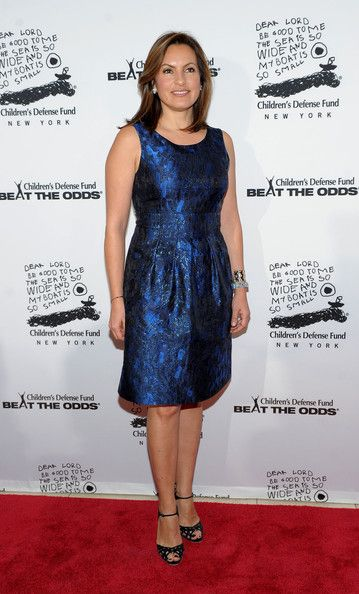 Mariska Hargitay, look she dresses her age! She is covered, classy and just because she's got them, doesnt mean she flaunts them!