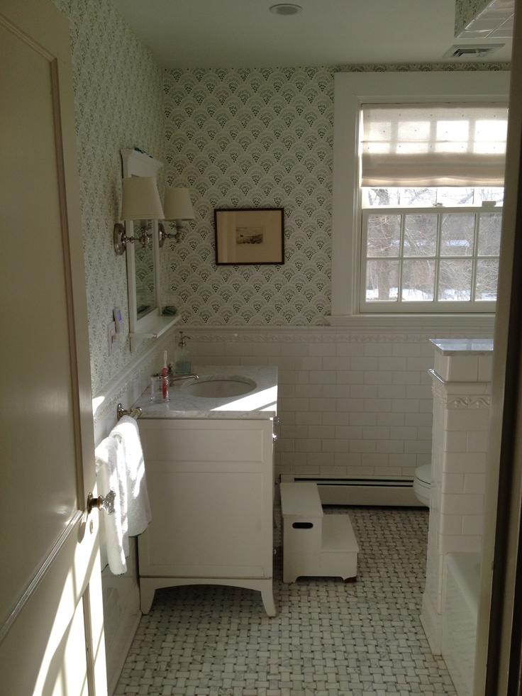 sister parish chou chou wallpaper waterworks vanity gray basketweave floor white subway tile