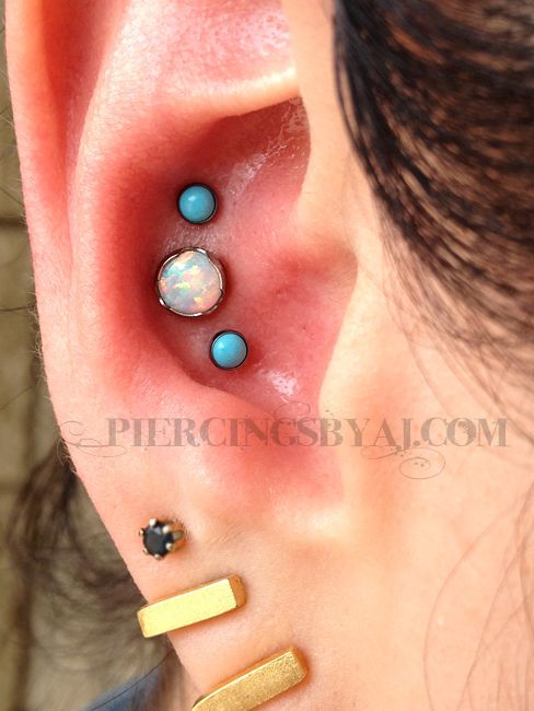 Fresh triple conch. 14g 5mm prong set white opal center piece from Anatometal with two 18g 3mm bezel set turquoise gems from Neometal.