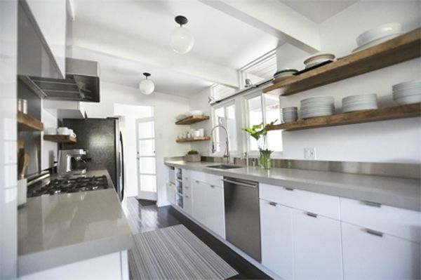 Wooden floating shelves in white and grey kitchen