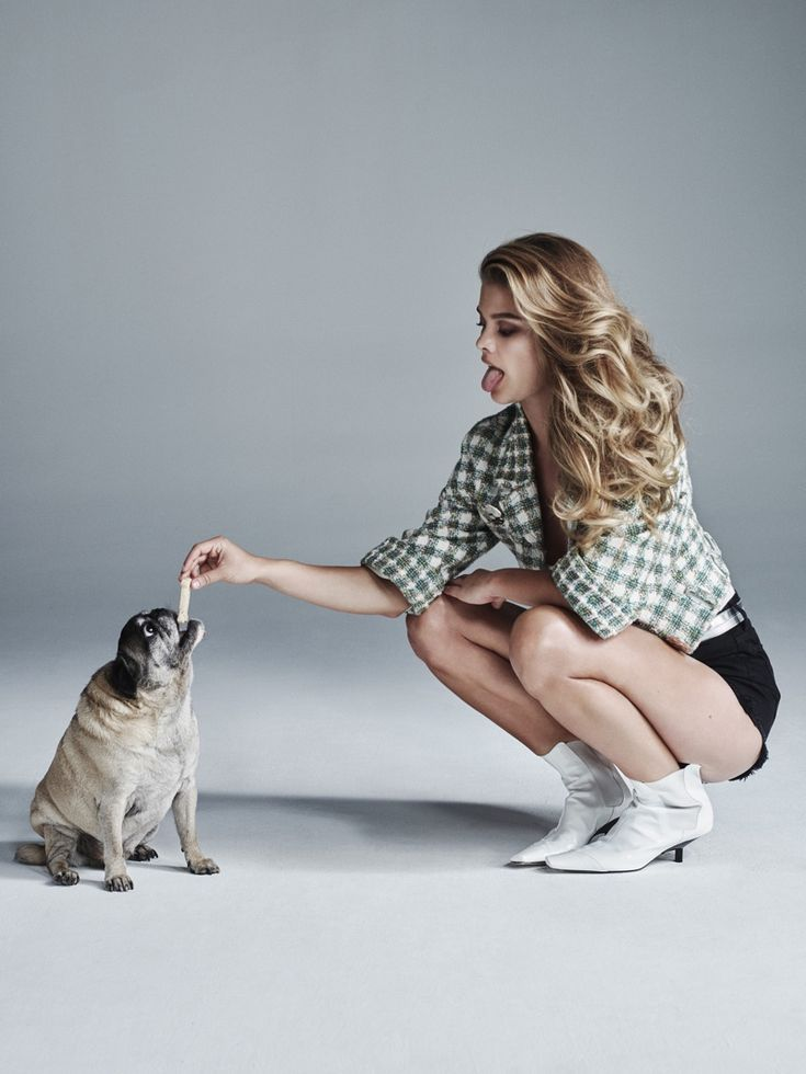 Nina Agdal is joined by a dog while wearing Chanel top and belt with Denim x Alexander shorts and Loewe boots
