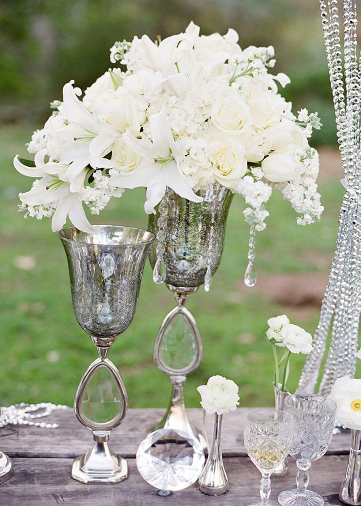 White flower centerpiece in silver vase vintage glam