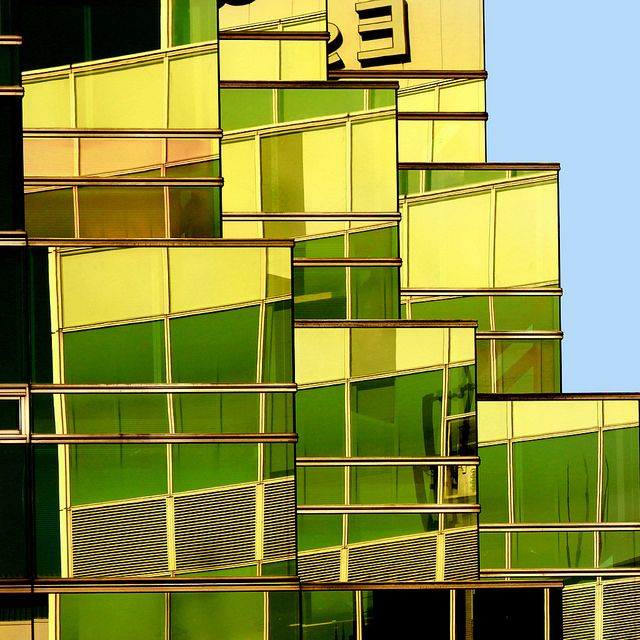 Urban fragment by Tanakawho.  Although clearly an image of a building, I like the way the unusual green colours, contribute to the abstract quality