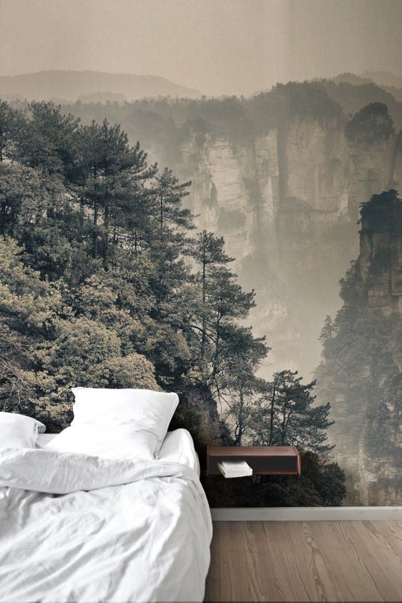 Wake up on top of the world with this landscape wallpaper mural. Faint sepia tones work beautifully in this modern bedroom, adding a vintage feel to your interiors.