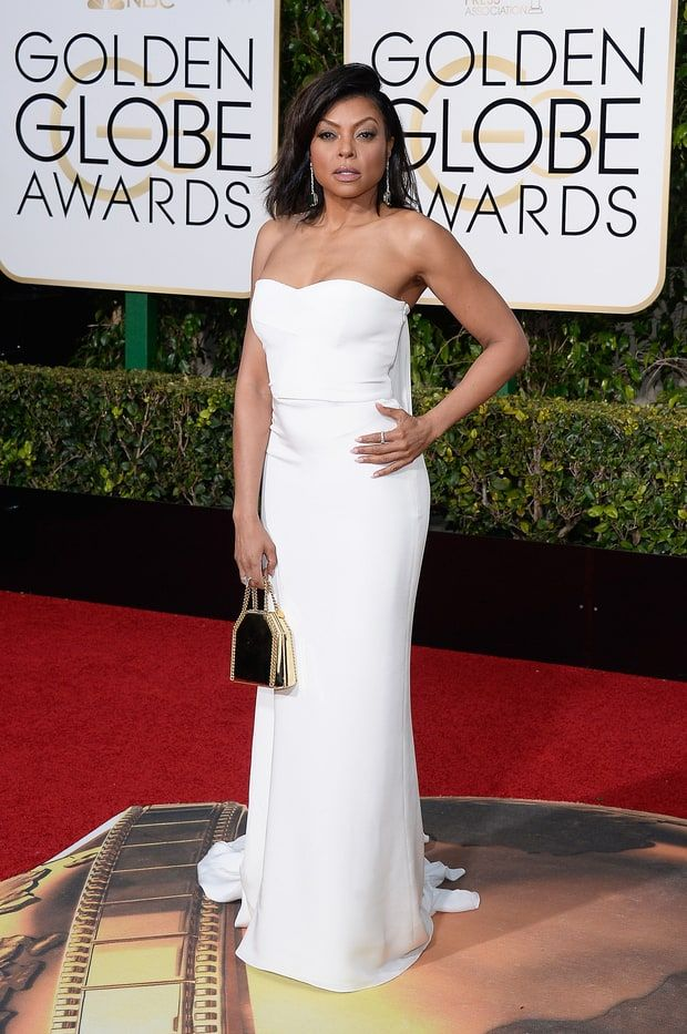 Taraji P. Henson walked the carpet in a strapless white dress with a watteau train, paired with a metallic chain purse and Kimberly McDonald jewelry. See more of the Golden Globes' best dressed stars here!