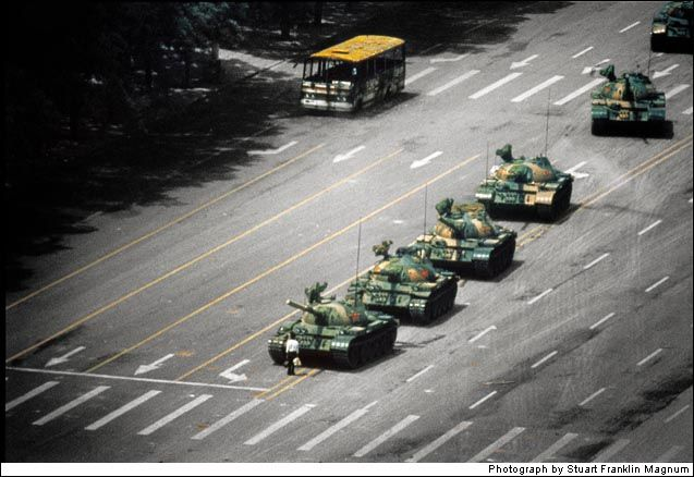 Jeff Widener took this picture during the 1989 Tiananmen Square protests (also known as the Tiananmen square massacre). It shows a man who had just had enough. His fate is unknown. He has as much chance of stopping the tanks as the protests did of changing the humanitarian consideration of the government. But he stood there anyway. The futility of his stance is as tragically beautiful as anything I've ever seen.