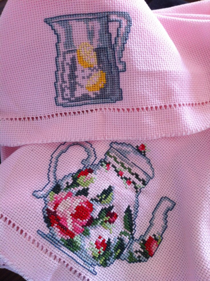 Teapot and Lemonade Carafe on pink fabric. Detail from table clothing - Coquette Collection