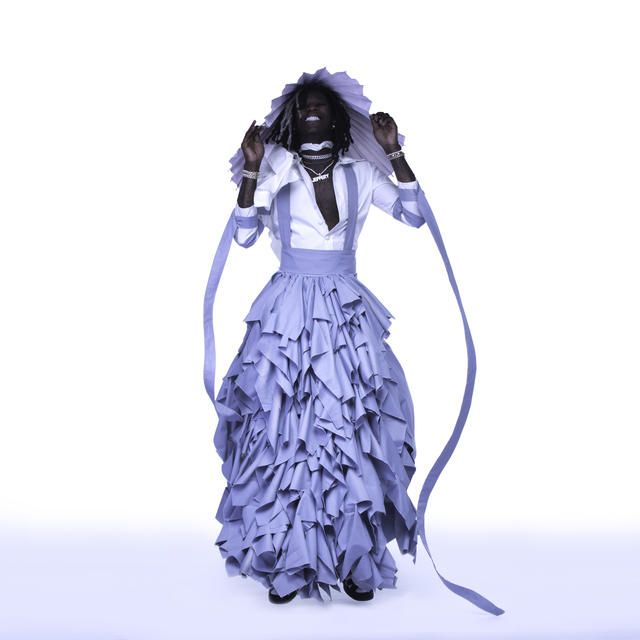 Rapper young thug, wearing a dress for its album cover