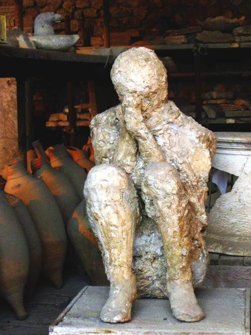 Plaster cast of a victim of the eruption of Vesuvius at Pompeii. The casts were obtained by filling with liquid plaster the hollow shapes left by the hardening of the lava around the corpses.