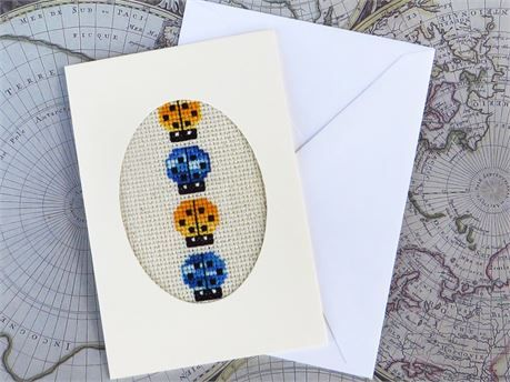 A small handmade card: 3 1/2 by 5 1/2 inches (just under 9 cm x 14 cm)