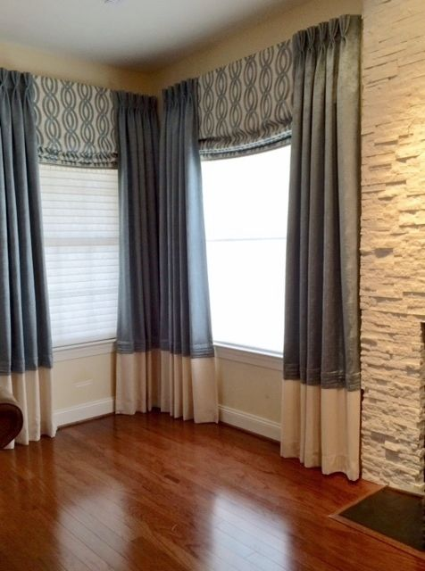 By Robinson Interiors, Jenkintown, PA.  Board mounted mock roman shades and draperies (also board mounted) with contrast french tucked hem.
