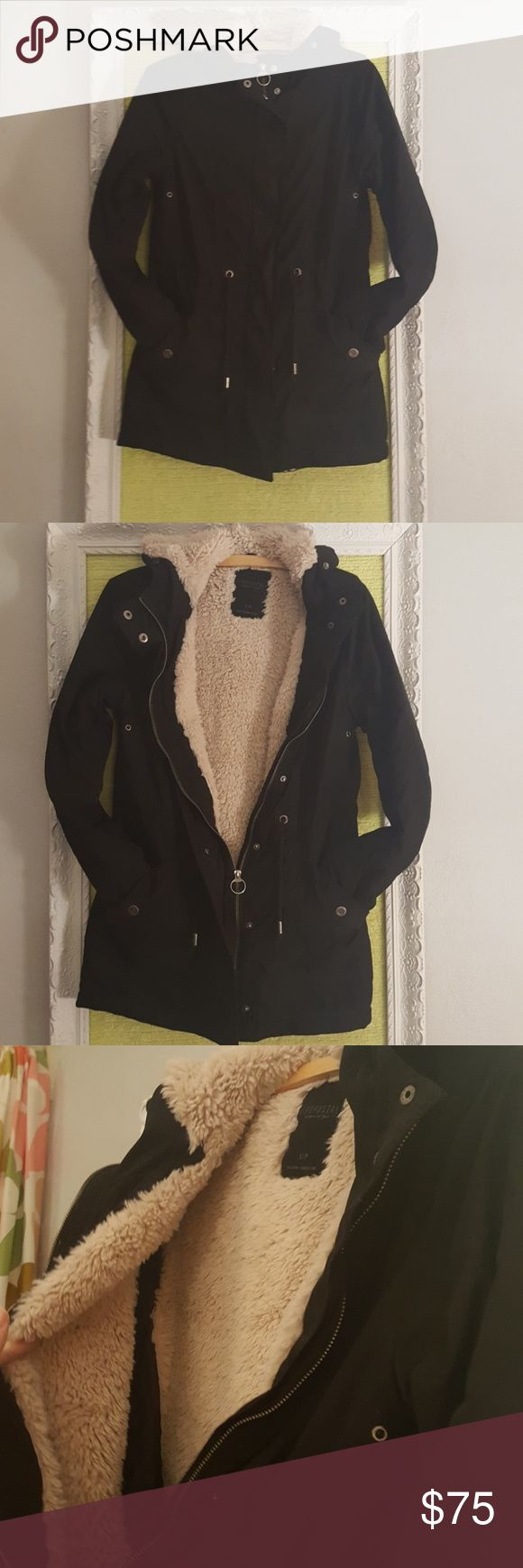 Parka-black Great warm parka, faux fur on hood and is in super condition and detachable.  Fuzzy warm fleece on the inside.  Wrist covers with thumb hole. Missing one button at the bottom but not noticable!! Aeropostale Jackets & Coats