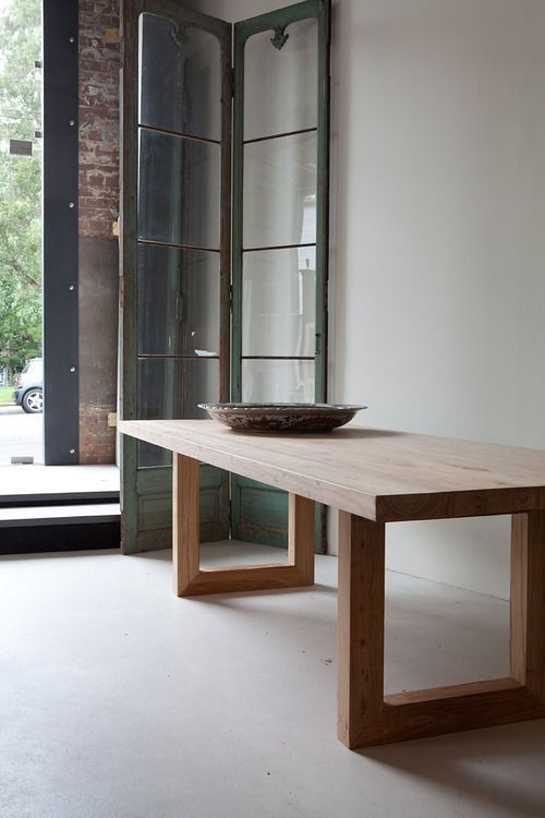 Global dining table, MCM House, Sydney. This would suit your cirrent furniture. With white chairs on the terrezzo floor would look fantastic.: