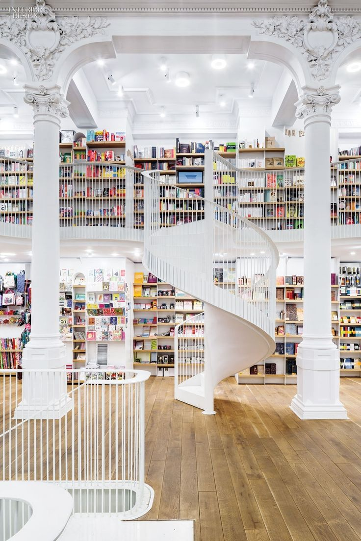 Square One added two mezzanines to the 19th-century building in Bucharest, Romania, that now houses the bookstore chain Carturesti's largest location. Photography by Cosmi...