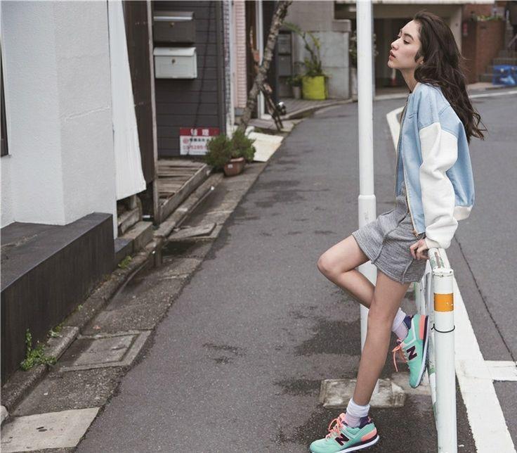 Sayo Yoshida (吉田 沙世) Pale blue letterman jacket, grey skirt and mint new balances taking a breather.