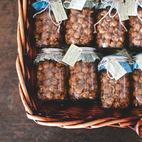 Mason jars filled with gourmet popcorn as favors