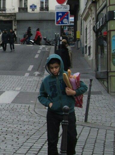 paris jan 14, boy with bread, 20th arrd