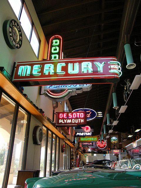 Vintage neon car dealer signs