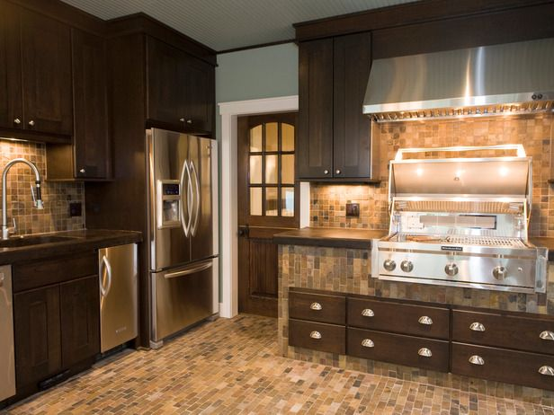 Professional Luxuries  Designer Shane Inman wanted to give a top-notch, contemporary kitchen the comfort of a small cook space by adding warm wood cabinetry and floor-to-ceiling tilework in a slew of cozy,