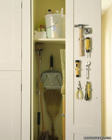 Make some version of this cabinet next to the water heater in laundry room for mop and broom