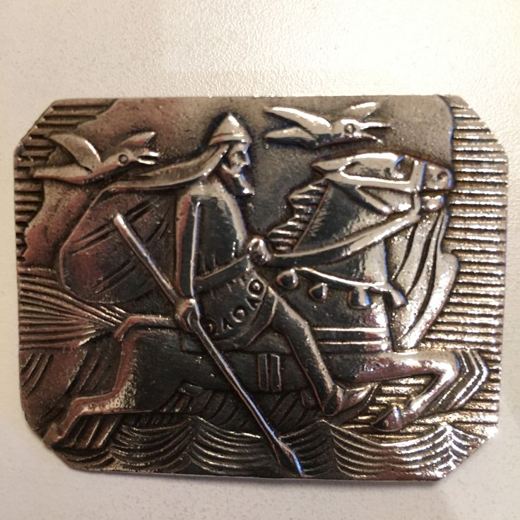 Gustav Gaudernack design for own workshop. Square silver brooch with motif from viking saga (the god Odin on his horse Sleipner and the ravens Hugin and Munin). 1910-1914