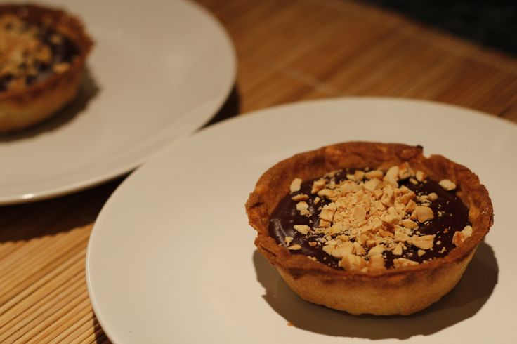 Chocolate and coffee liqueur tarts with crushed hazelnuts