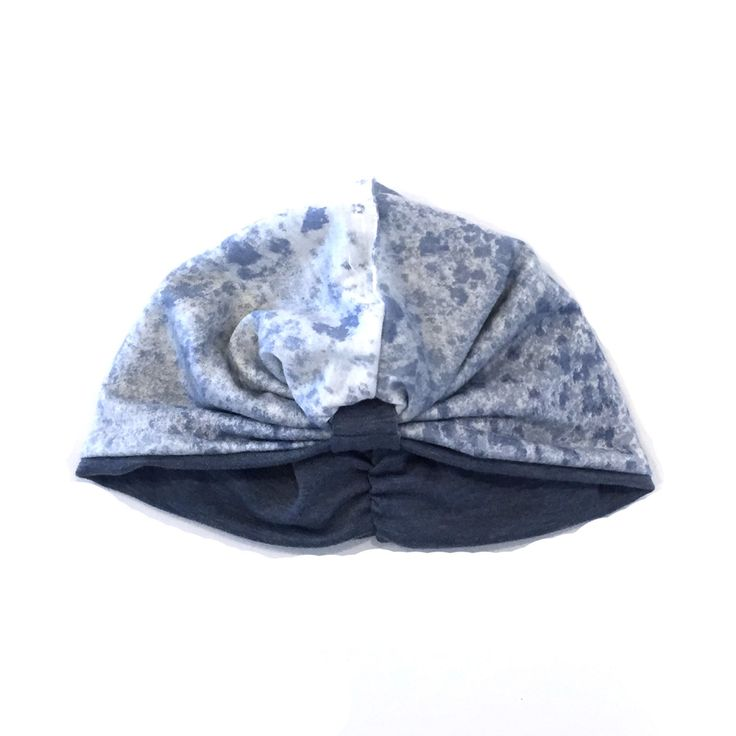 The blue wash turban hat is a stylish reversible hat made from comfortable stretch fabric with a special looped detail in the front and short shirring in the back to allow for the most comfortable fit. Please note that color may vary slightly due to the brightness and clarity of your computer screen.