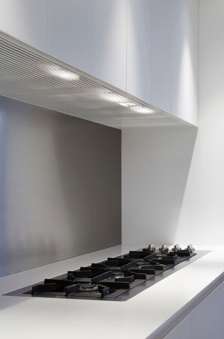 Stainless steel hob and Corian work-top by Domus Funriture _