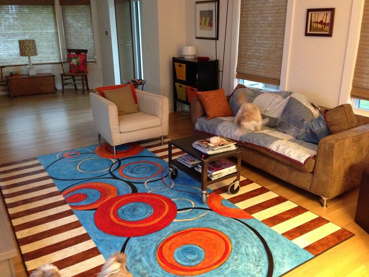 """Custom""""Circles and Stripes Contemporary"""" floorcloth in the living room."""