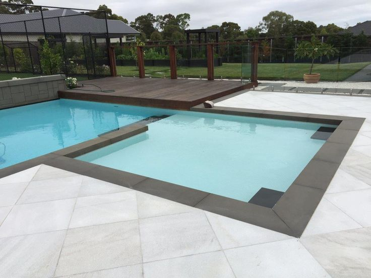 Harkaway Bluestone pool coping tile paired with white quartzite premium pool tiles #wowfactor #bluestone #pool #summerready